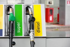 gasoline pump nozzles at petrol station