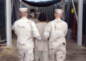 Captive_being_escorted_for_medical_care,_December_2007